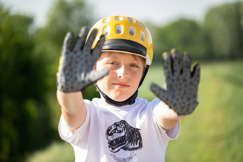 boy with bike gloves and helmet