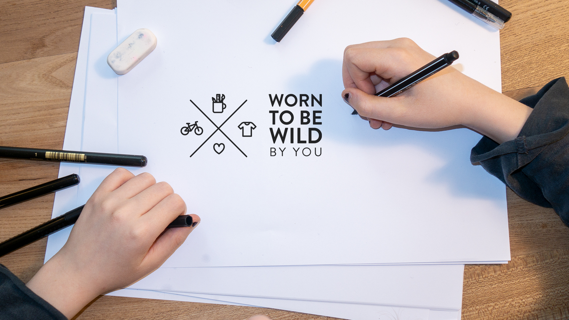 WORN TO BE WILD by woom Logo